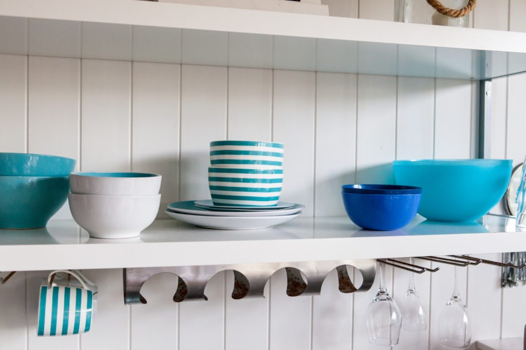 assortment of colorful plastic bowls on a shelf